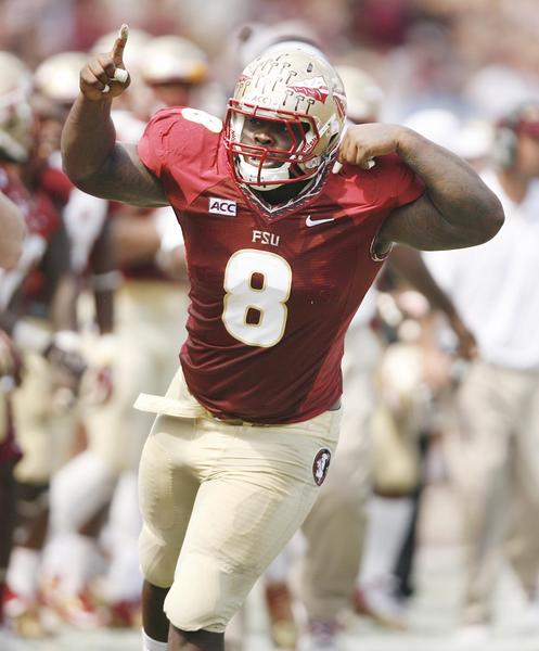 FSU defensive tackle Timmy Jernigan celebrates after a hit during the Maryland at FSU football game at Doak Campbell Stadium on Saturday, October 5, 2013. (Stephen M. Dowell/Orlando Sentinel)