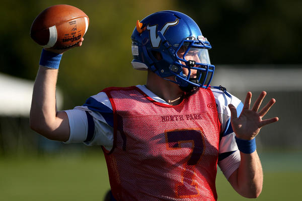 North Park University quarterback T.D. Conway throws during a recent practice. He fired three TD passes Saturday.