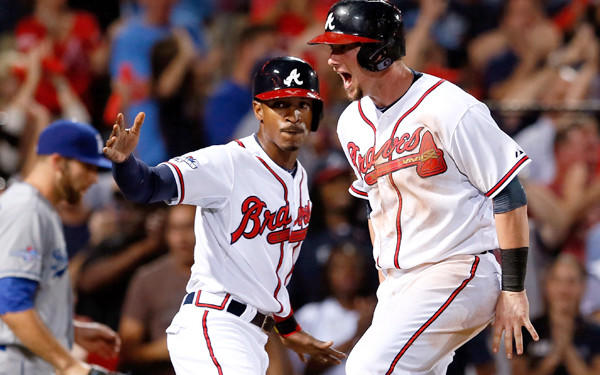 Braves players B.J. Upton, left, and Chris Johnson had plenty to celebrate with a Game 2 victory on Friday night. TBS announcers had to be pleased with the outcome, too.