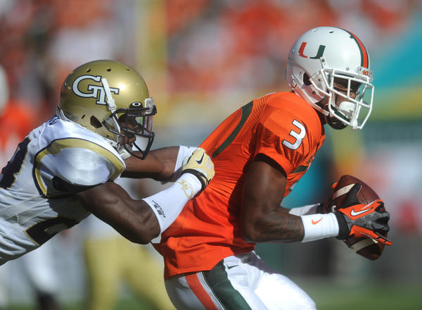 Stacy Coley of the University of Miami hauls in a catch as D.J. White of Georgia Tech closes in on the play. Georgia Tech at University of Miami, Sun Life Stadium, Miami Gardens, FL. 10/5/13. Jim Rassol, Sun Sentinel..