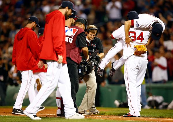 David Ortiz picks up Koji Uehara after the 7-4 win.