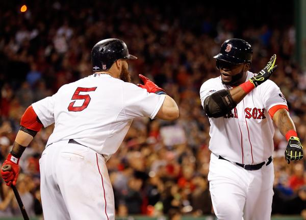 David Ortiz of the Red Sox celebrates a home run in the eighth inning with Jonny Gomes (5) against the Tampa Bay Rays during Game 2 of the American League Division Series at Fenway Park.