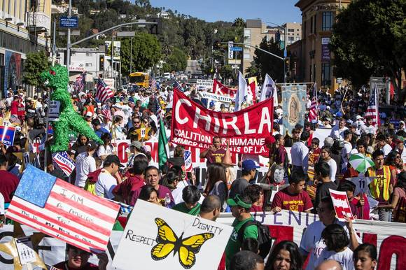 Immigrants-rights demonstrators fill the streets at Hollywood Boulevard and Western Avenue in L.A.