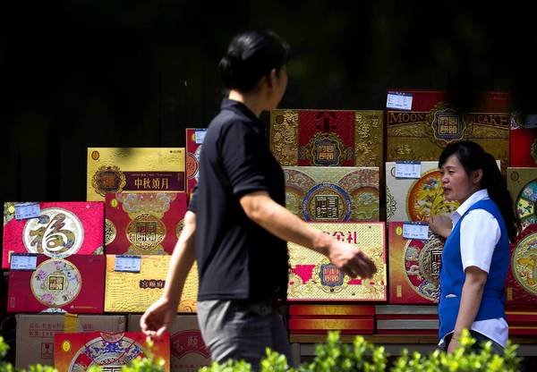 A counter displays fancy boxes of mooncakes, a popular holiday gift, outside a shopping mall in Beijing. Last month, the Chinese government banned the use of public funds to buy mooncakes.