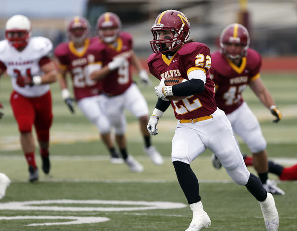 Northern State University's Channing Barber (22) finds room to run as he took a punt fake 60 yards for a touchdown in the first half of Saturday's game at Swisher Field.
