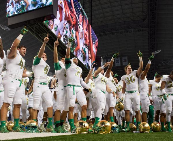 Notre Dame players sing the Alma Mater after the win.