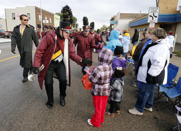 Members of the Northern State University Marching Band broke formation from time to time to interact with the crowd as they made their way down Main Street Saturday during the Gypsy Day parade. American News Photo by John Davis