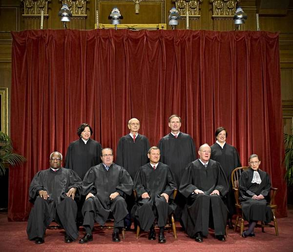 Supreme Court justices gather for a portrait. A conservative bloc on the court will have a clear chance in the fall term to shift the law to the right on key social issues such as abortion, contraception and religion.