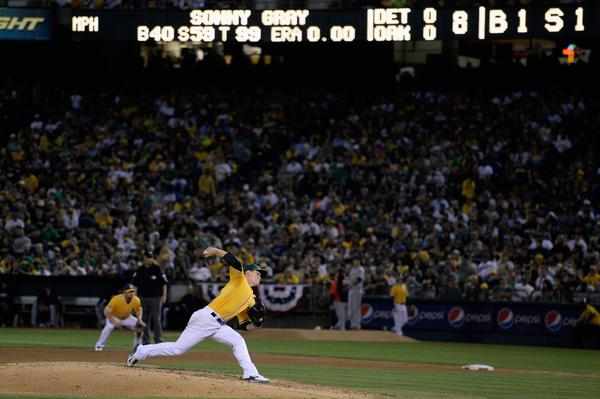 A's starter Sonny Gray throws a pitch in the eighth inning against the Tigers.