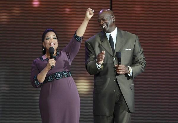 "Oprah Winfrey is surprised by Michael Jordan while taping the second of two ""Surprise Oprah! A Farewell Spectacular"" episodes of the Oprah Winfrey Show."
