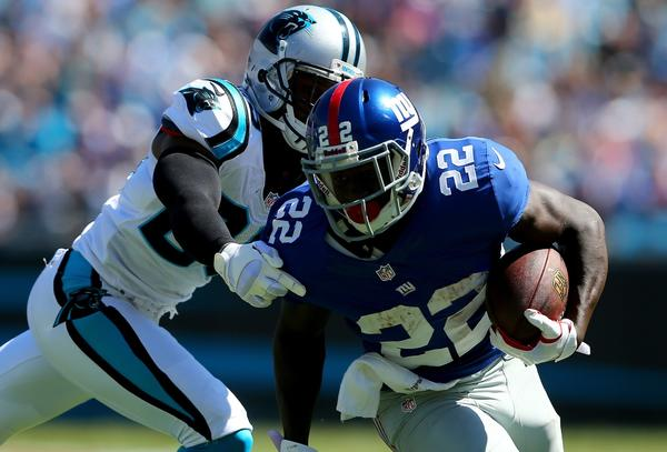 Drayton Florence of the Carolina Panthers goes after David Wilson of the New York Giants during their game at Bank of America Stadium on Sept. 22.