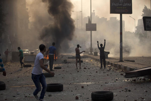 Supporters and opponents of Egypt's ousted Islamist President Mohamed Morsi clash in Cairo on Sunday.