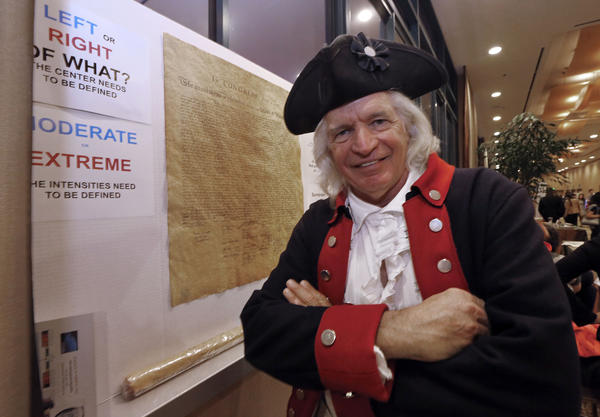 "Author Steven Maikoski poses as George Washington next to a replica of the Declaration of Independence at his booth, ""Arguing for the Constitution,"" at the California Republican Party convention in Anaheim."