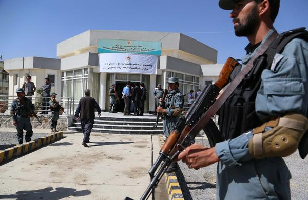 Afghan police secure the venue where presidential candidates are registering on the last day of sign-ups in Kabul, Afghanistan, on Sunday.