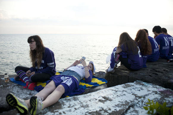 Freshman Northwestern students hang out by the lake before College GameDay begins at 2400 Campus Drive, Evanston, IL on October 5, 2013.