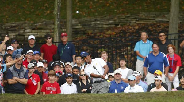 Tiger Woods hits from the rough on the 15th hole during his match against Richard Sterne of South Africa.
