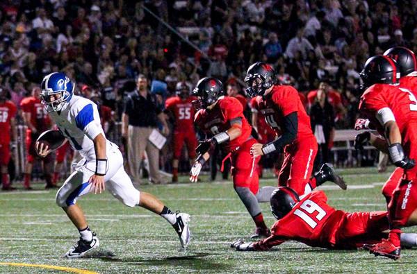 Palisades quarterback Taylor Mensik scrambles for a gain against Harvard-Westlake.