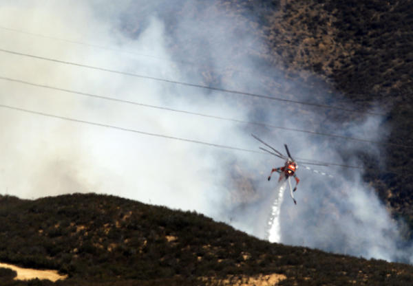 A helicopter drops water on the so-called Baker fire in Orange County near the Cleveland National Forest.