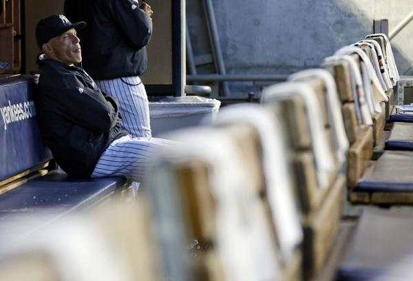 Yankees manager Joe Girardi sits in the dugout prior to their game with the Rays.