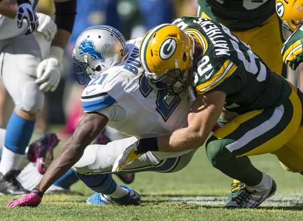 The Packers' Clay Matthews makes a tackle on the Lions' Reggie Bush.