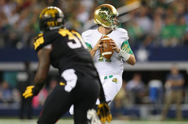 Tommy Rees throws the ball against Arizona State at Cowboys Stadium.