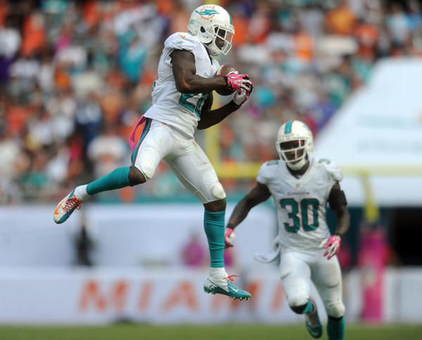 Reshad Jones of the Miami Dolphins intercepts a pass and returns it for a touchdown in the fourth quarter against the Ravens. Baltimore Ravens at Miami Dolphins. Sun Life Stadium, Miami Gardens, FL. 10/5/13. Jim Rassol, Sun Sentinel...