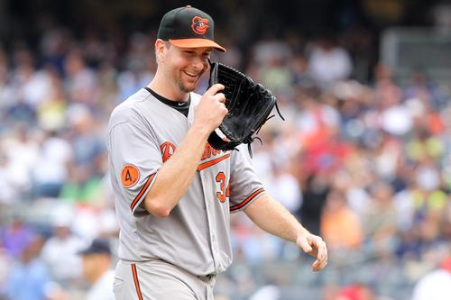 Orioles starting pitcher Scott Feldman reacts after getting a double play to end the fifth inning against the New York Yankees on Saturday.