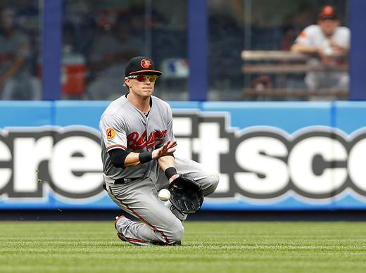 Orioles left fielder Nate McLouth can't catch the ball hit by the New York Yankees' Curtis Granderson in the sixth inning Saturday.