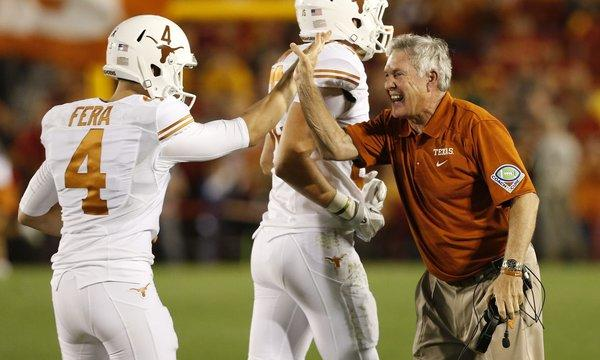 Texas Coach Mack Brown, right, celebrates with kicker Anthony Fera during the Longhorns' win over Iowa State on Thursday.