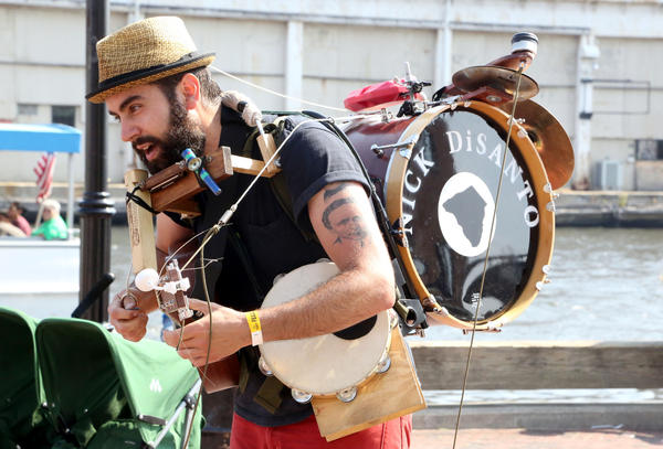 Musician Nick DiSanto plays music for kids at the Fells Point Fun Festival.