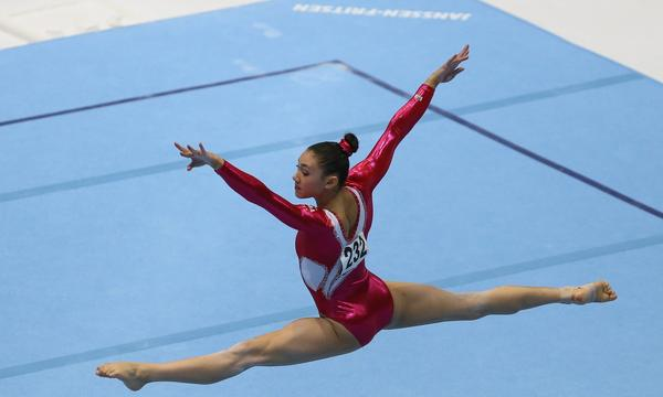 Kyla Ross performs her floor exercise routine at the gymnastics world championships in Belgium on Sunday.
