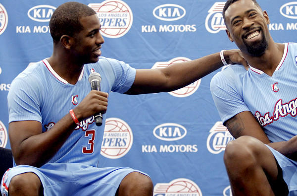 Clippers point guard Chris Paul horses around with center DeAndre Jordan during media day.