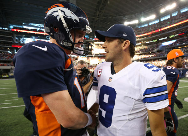 Broncos quarterback Peyton Manning meets with Cowboys quarterback Tony Romo at the end of the game.