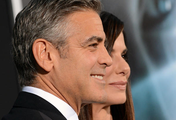 """Actors George Clooney and Sandra Bullock attend the premiere of """"Gravity"""" in New York on Oct. 1, 2013."""
