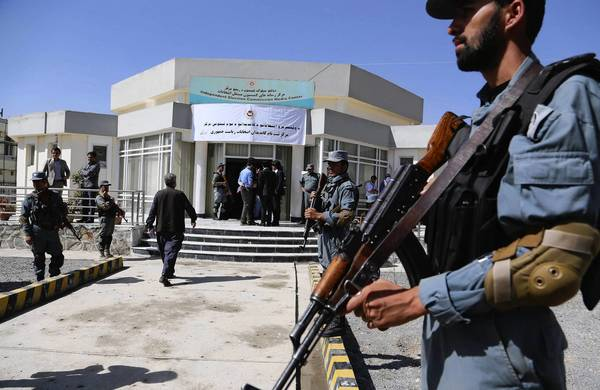 Afghan police guard the registration venue for presidential candidates in Kabul, the capital. About 20 people reportedly have registered to run in the April 2014 election.