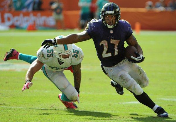 Miami Dolphins Koa Misi misses a tackle on the Ravens Ray Rice Ryan during the third quarter against the Baltimore Ravens in Sun Life Stadium in Miami Gardens, Sunday, Oct. 6, 2013.Joe Cavaretta, SunSentinel (c)2013..