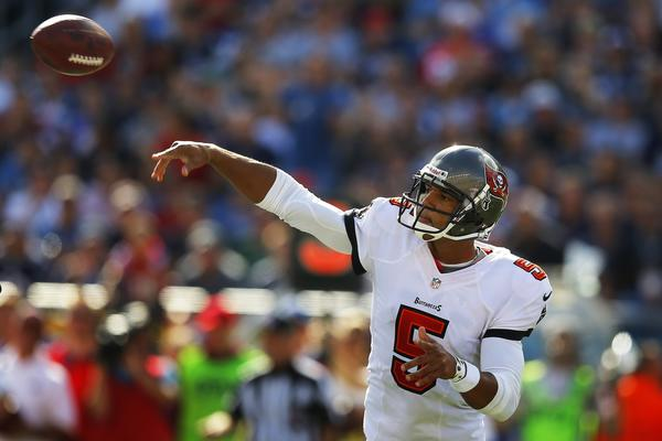 Former Buccaneers quarterback Josh Freeman passes the ball against the Patriots.