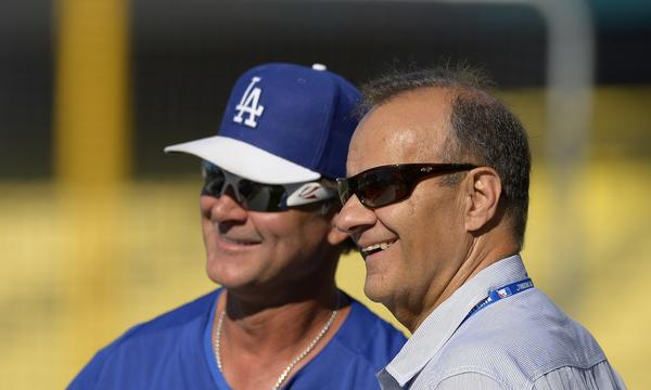 Former Dodgers manager Joe Torre, right, understands what Don Mattingly is experiencing in regard to his former protege's current contract situation.
