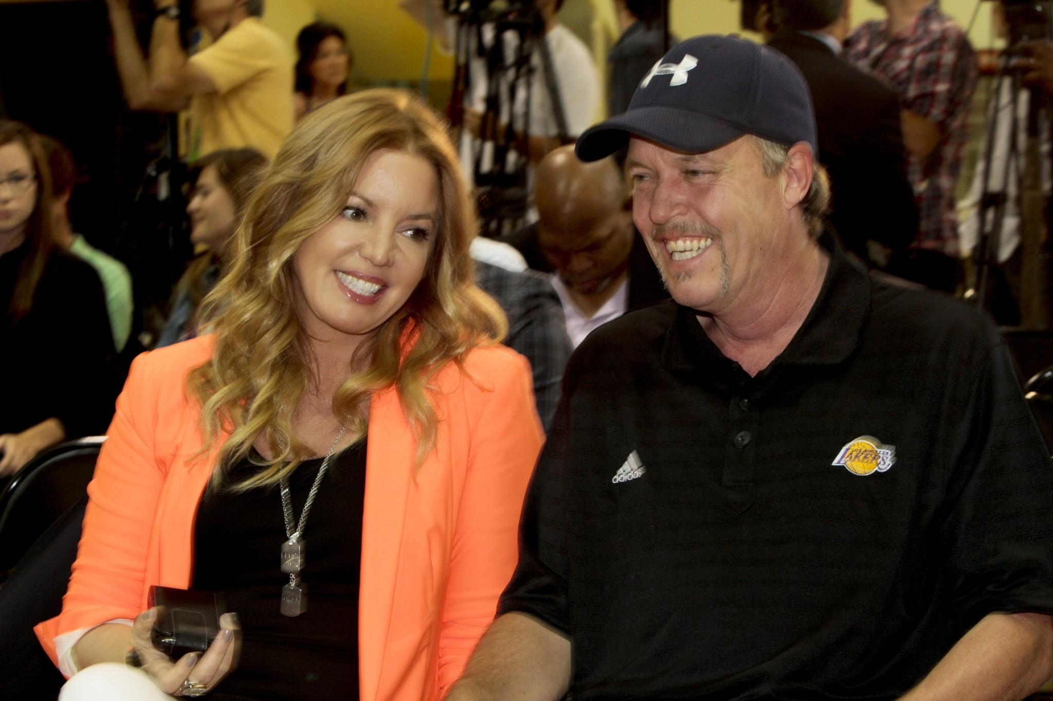 "In her updated memoir, ""Laker Girl,"" Lakers executive Jeanie Buss says she was ""devastated"" after her brother, Jim Buss, right, decided not to hire Phil Jackson to replace the fired Mike Brown as coach."