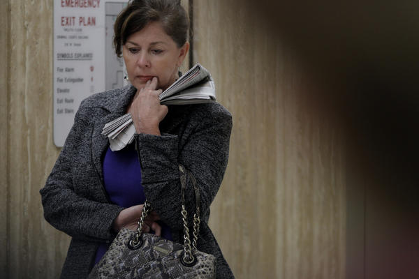 Former Bell assistant city manager Angela Spaccia stands outside a courtroom after a pretrial hearing in Los Angeles.
