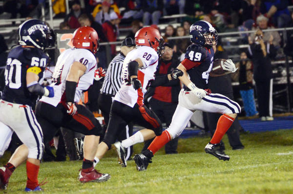 Boyne City linebacker Max Cuper (right) returns his third quarter interception off East Jordan quarterback Dustin Hejka 25 yards down the left sidelines as East Jordans Wyatt Crick (20) and Ben Walton (40) give chase Friday in Boyne City. The Ramblers defeated the Red Devils, 41-0.