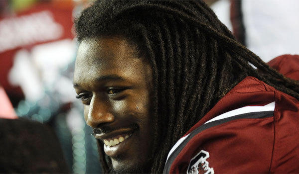 South Carolina defensive end Jadeveon Clowney appears to be in good spirits as he sits out the Gamecocks' matchup against Kentucky on Saturday.