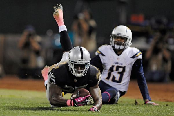 Oakland cornerback D.J. Hayden intercepts a pass in the endzone intended for San Diego receiver Keenan Allen on Sunday night.