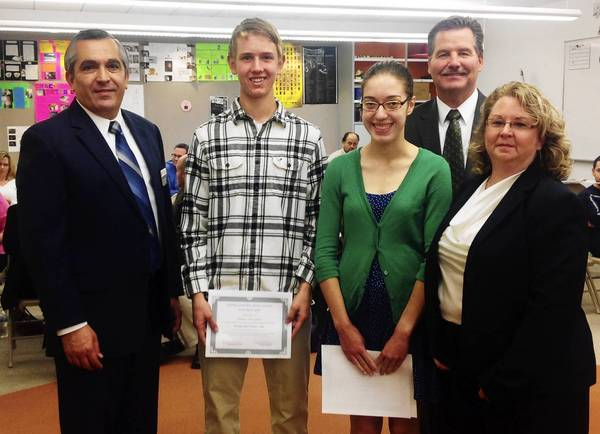 District 230 School Board President Rick Nogal, left, Superintendent Dr. James M. Gay and School Board member Susan Dalton recognized Sandburg seniors Adam Gleisner and Paige Kordas for perfect ACT scores.