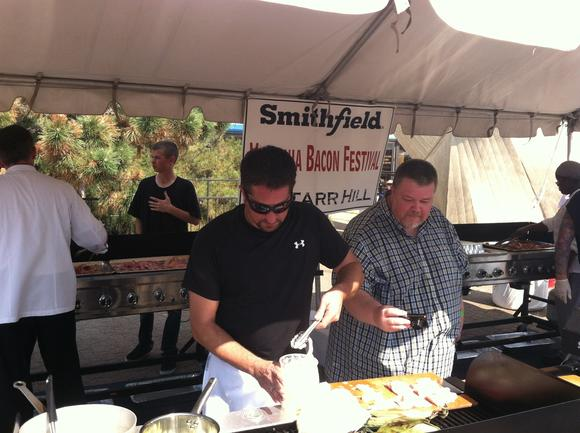 Chef  Mike Farrell (left) creates a bacon dish while judge Patrick Evans-Hylton looks on at the Virginia Bacon Festival Oct. 5 in Norfolk
