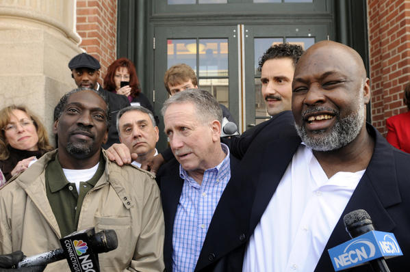 Ronald Taylor (at left) and George Gould (at right) rejoice in front of Superior Court in Vernon, Conn. on April 1, 2010 after the judge reversed their murder convictions and released them after serving 16 years in prison. Taylor and Gould were convicted of a 1993 New Haven murder. At center is investigator Gerry O'Donnell who played a key role in their release.