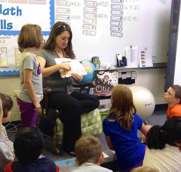"Danya Sundh is pictured with her students during Read for the Record as they read this year's book ""Otis"" by Loren Long."