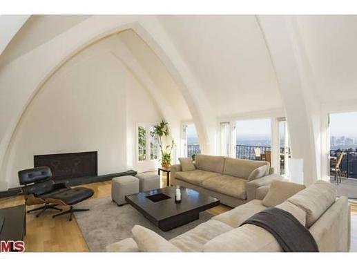 A high arched ceiling creates drama in the living room.