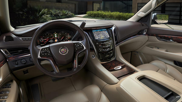 The interior of a 2015 Cadillac Escalade.