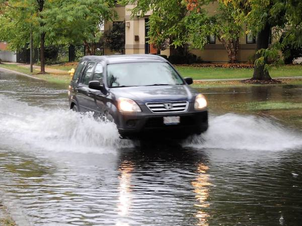 Saturday's storm caused some street flooding in Elmhurst, including the intersection at Arlington and Crescent avenues.